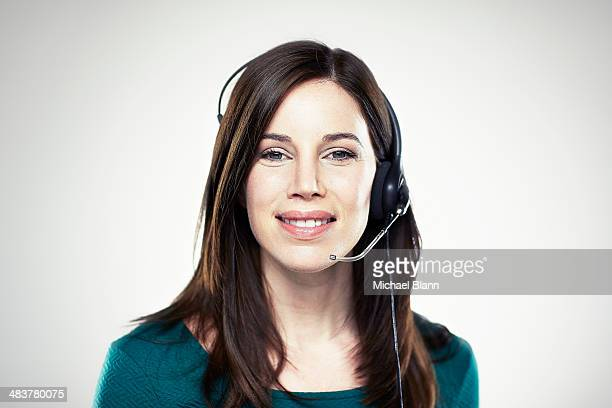 Portrait of woman with telephone head set