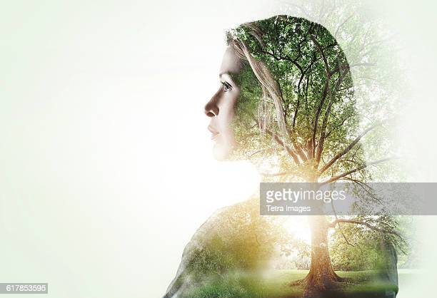 Portrait of woman with trees in background