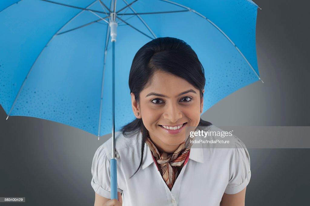 Portrait of woman with umbrella : Stock Photo