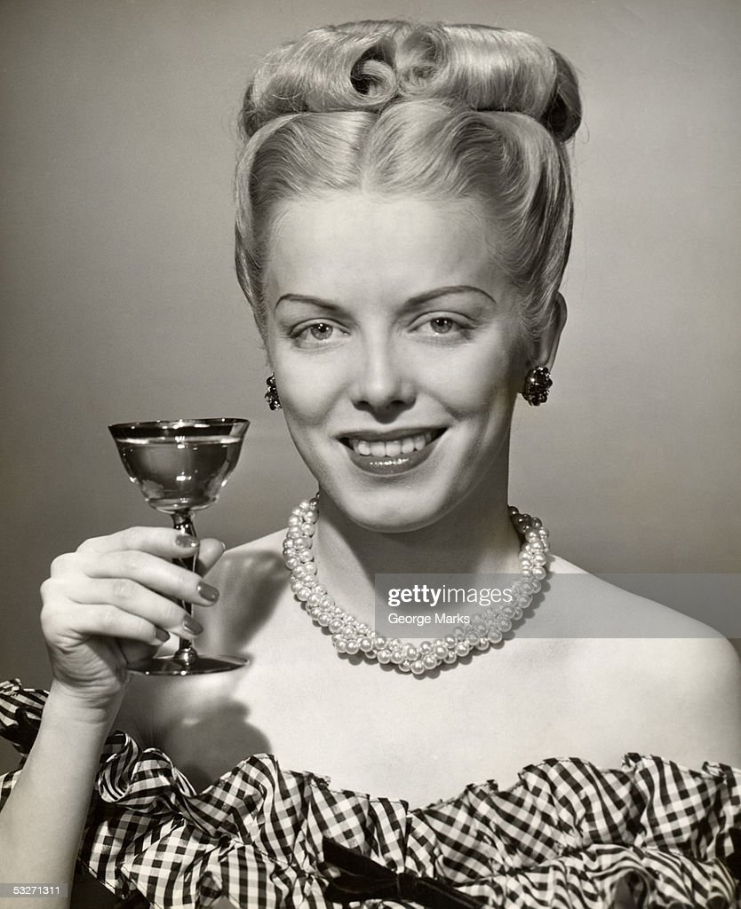 Portrait of woman with upraised glass : Foto de stock