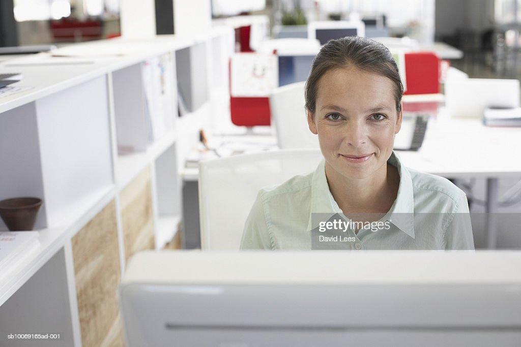 Portrait of woman working in office : Stockfoto