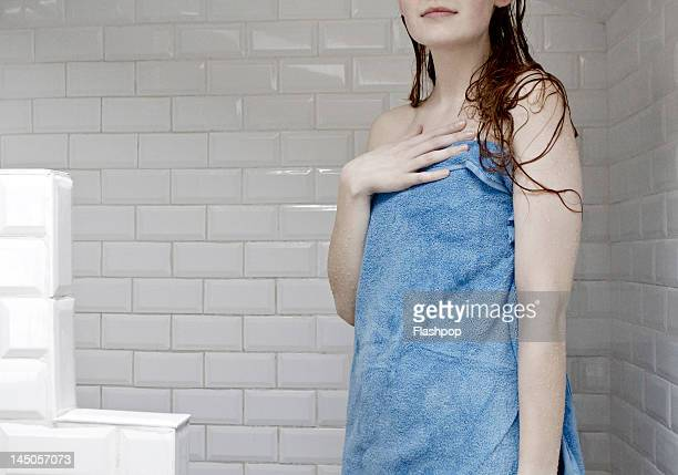 portrait of woman wrapped in towel after a shower - wrapped in a towel stock pictures, royalty-free photos & images