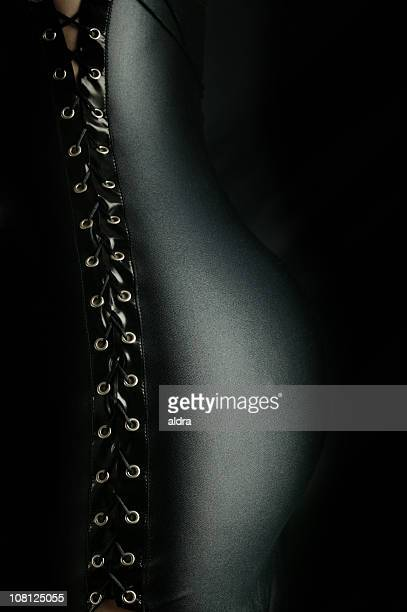 Portrait of Woman's Back Wearing Corset Lace Up