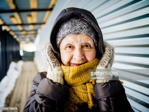 portrait of women 74 old outdoors in winter - winter weather stock photos and pictures