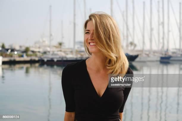 portrait of women at yacht parking - vestido preto imagens e fotografias de stock