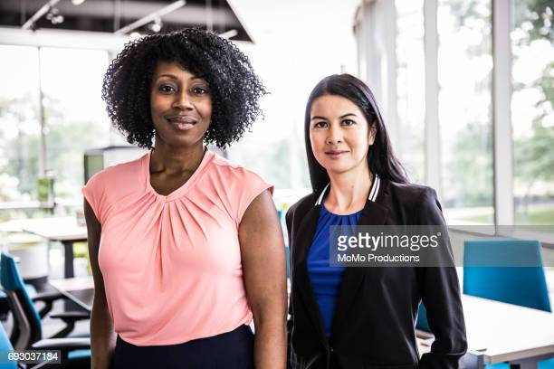 portrait of women in modern business office - side by side stock pictures, royalty-free photos & images