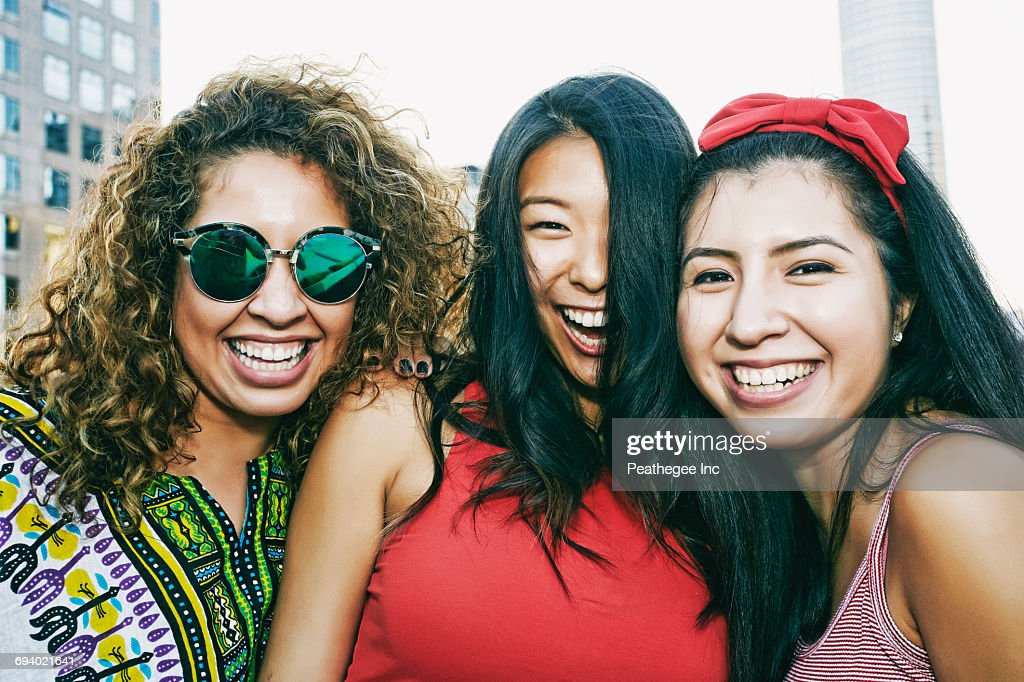 Portrait of women smiling on urban rooftop : Stock Photo