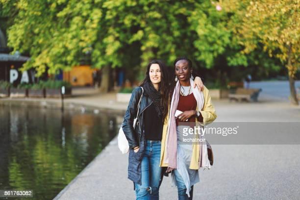 Portrait of women walking in London Victoria park