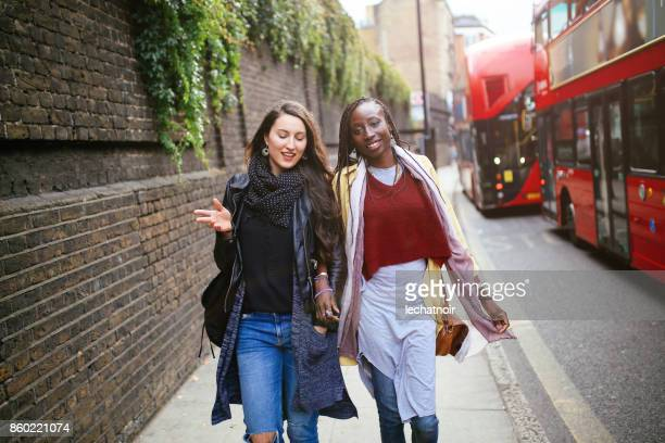 portrait of women walking in shoreditch, london - shoreditch stock photos and pictures