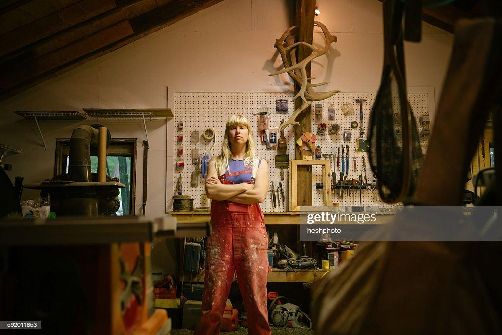 Portrait of wood artist in workshop : Stock Photo