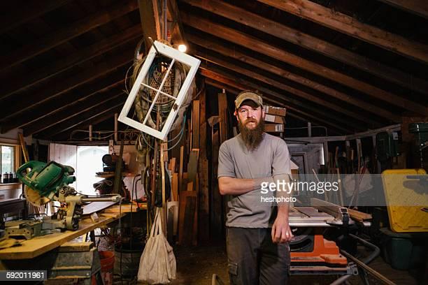 portrait of wood artist in workshop - heshphoto stock-fotos und bilder