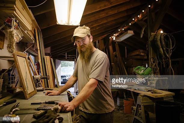 portrait of wood artist working in workshop - heshphoto stock pictures, royalty-free photos & images