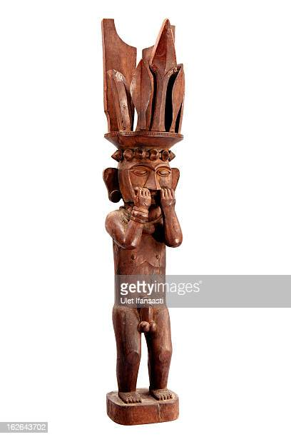 A portrait of wooden statue souvenir by artist Hiburan Zagoto in Bawomataluwo village on February 21 2013 in Nias Island Indonesia Some of historians...