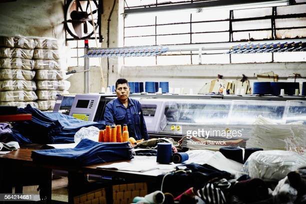Portrait of worker at workbench in textile factory
