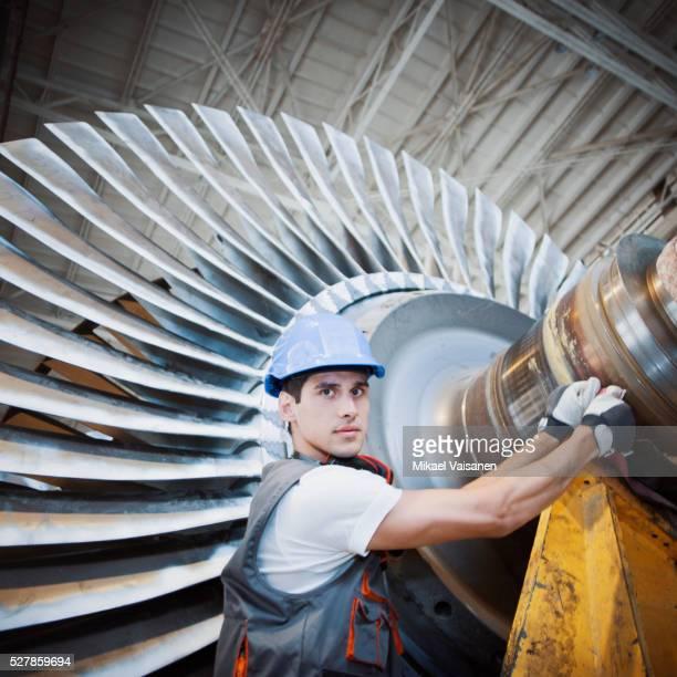 Portrait of worker handling turbine