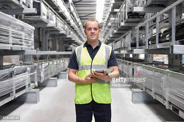 Portrait of worker in engineering warehouse