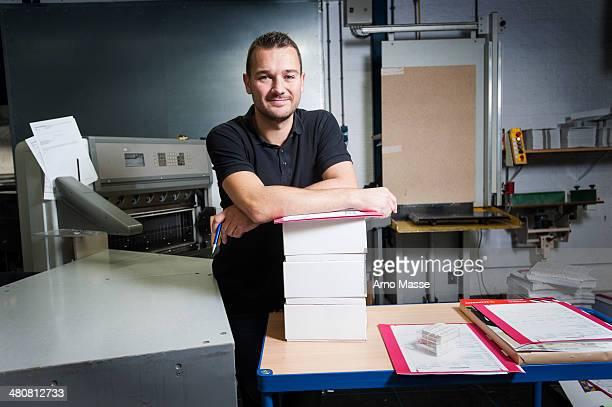 Portrait of worker in paper printing workshop
