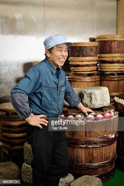 Portrait of worker of pickles factory