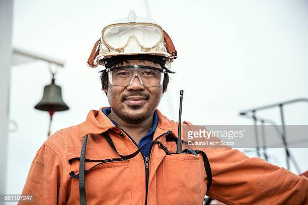 portrait of worker on oil tanker - dock worker stock photos and pictures
