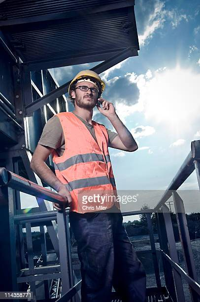 portrait of worker talking on mobile phone