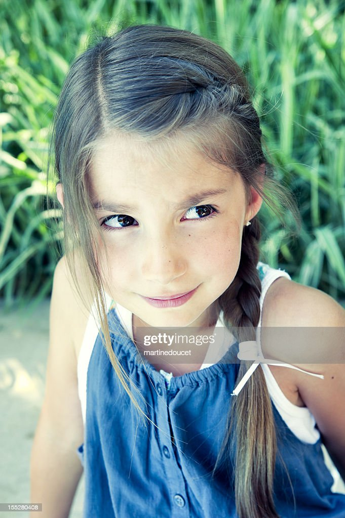 Portrait of worried little girl by the pool. : Stock Photo
