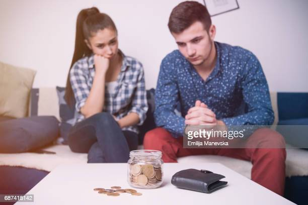 Portrait of worried young couple looking at their savings