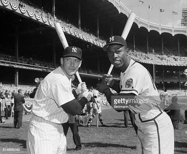 Portrait of Yankee outfielders Mickey Mantle and Hank Aaron posing in batting stance