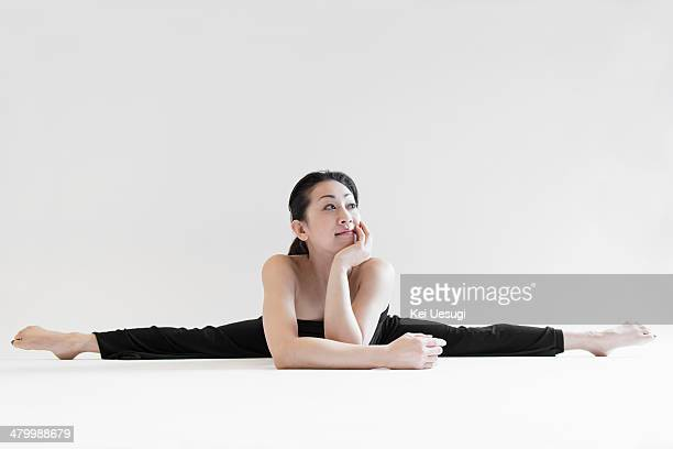a portrait of yoga woman. - doing the splits stock pictures, royalty-free photos & images