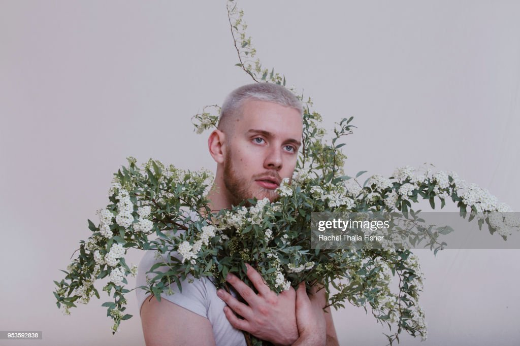 Portrait of young adult male in studio : Stock Photo