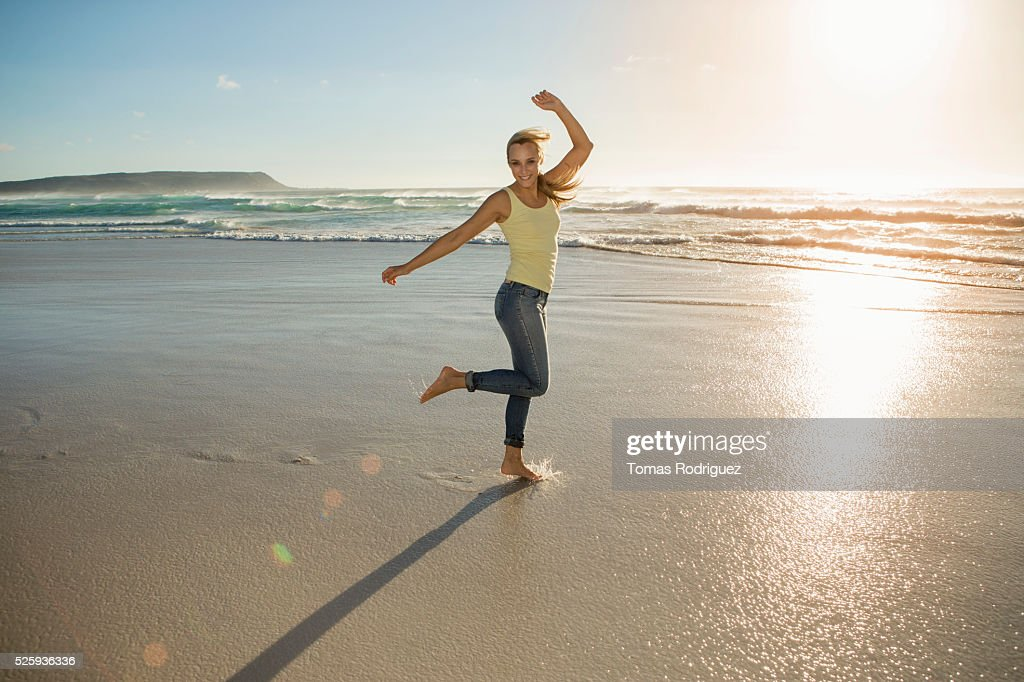 Portrait of young adult woman standing on beach : Stock Photo