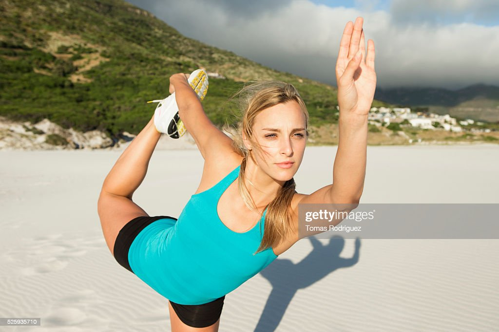 Portrait, of, young adult woman, stretching : Stock Photo
