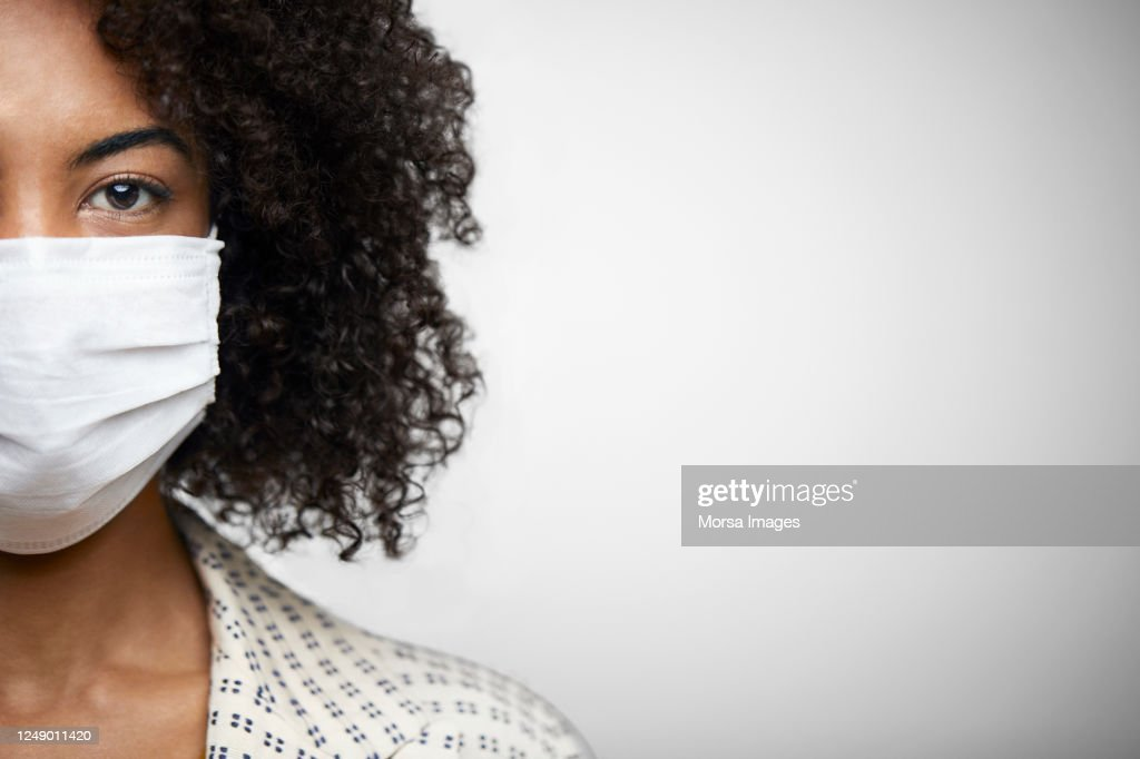 Portrait Of Young African American Female With N95 Face Mask. : Stock Photo
