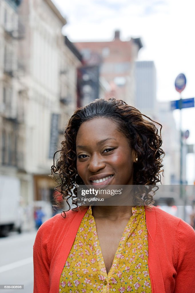 Portrait of young African American woman in downtown city : Stock-Foto