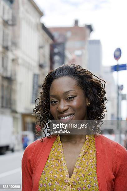 portrait of young african american woman in downtown city - new yorker building stock photos and pictures
