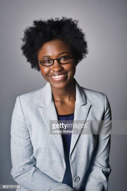 portrait of young african american woman - grey blazer stock pictures, royalty-free photos & images