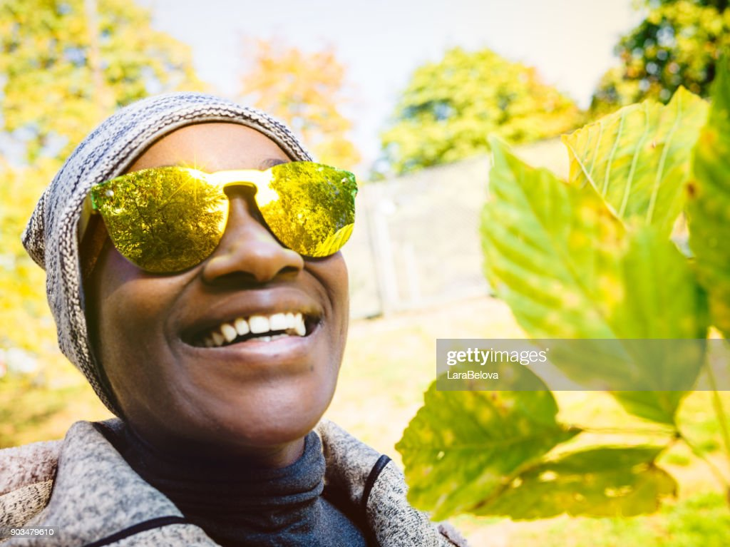 Portrait of young African woman in park : Stock Photo