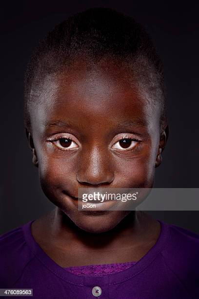 Portrait of young African-American girl, smiling
