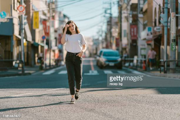 portrait of young and beautiful woman with no make up - white trousers stock pictures, royalty-free photos & images