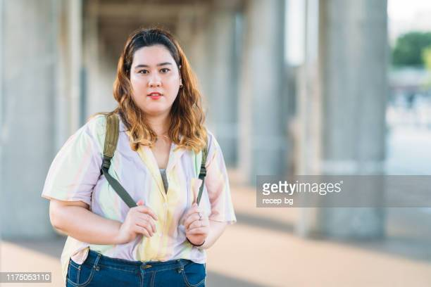 portrait of young and fashionable woman - curvy asian woman stock pictures, royalty-free photos & images