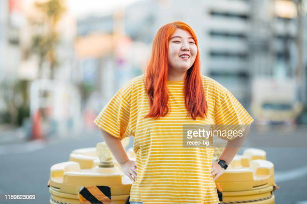 portrait of young and happy woman - curvy asian woman stock pictures, royalty-free photos & images