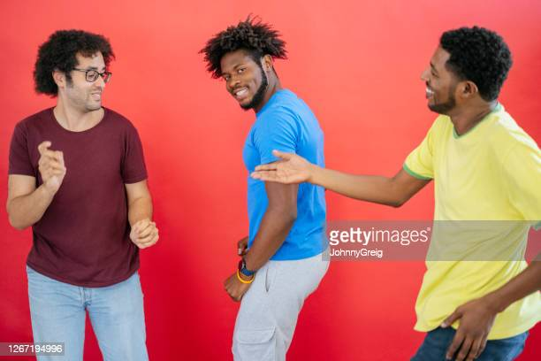 portrait of young and mature black male friends dancing - royal blue stock pictures, royalty-free photos & images