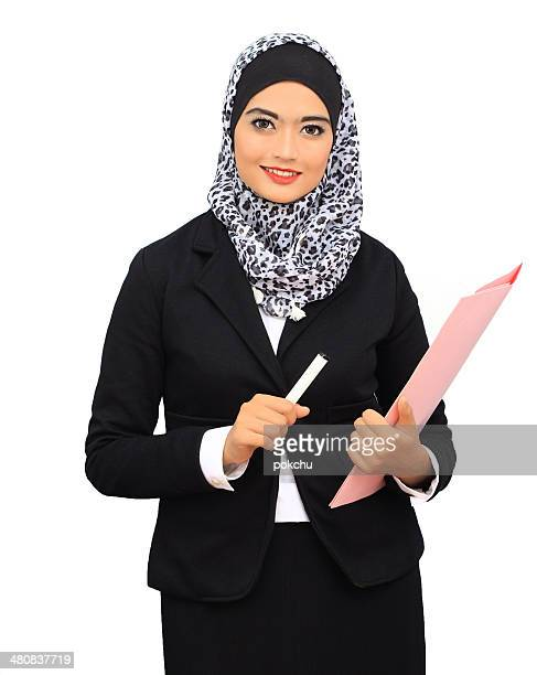 Portrait of young and successful businesswoman holding file folder