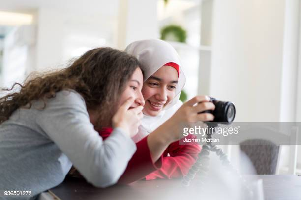 Portrait of young Arabic sisters hanging out together