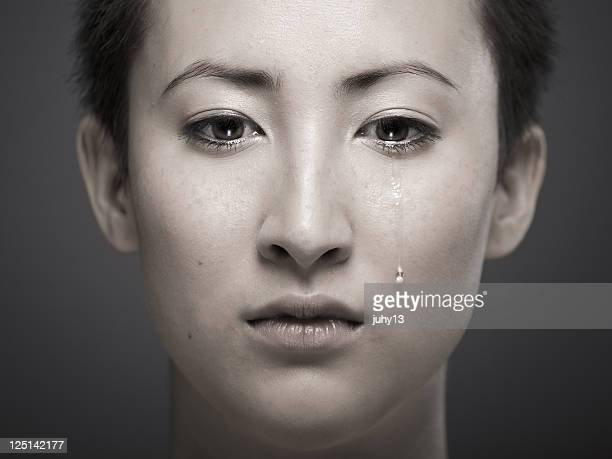portrait of young asian girl with tear rolling down cheek - mongolian women stock photos and pictures