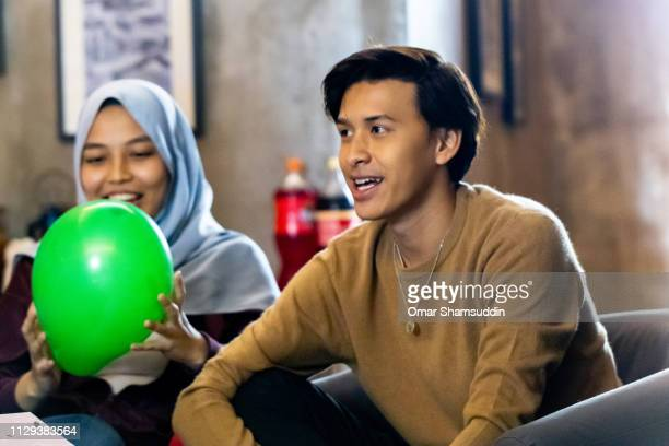 Portrait of young Asian guy at birthday party