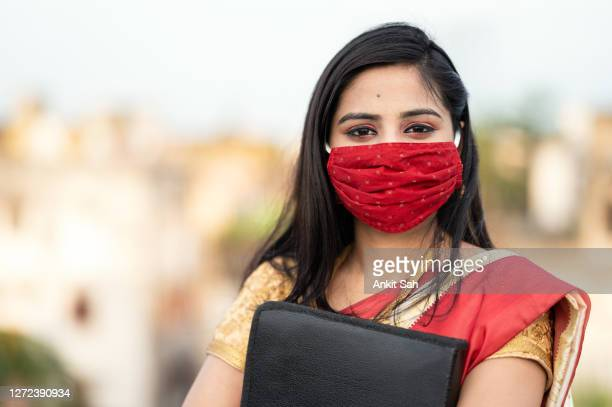 portrait of young asian/ indian businesswoman in sari - india stock pictures, royalty-free photos & images