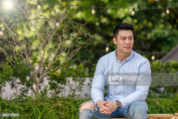 portrait of young asian man - handsome chinese men stock pictures, royalty-free photos & images