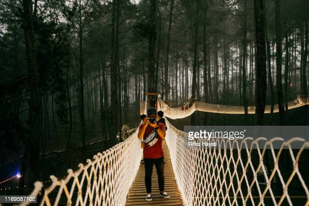 portrait of young asian man traveler in bandung - bandung stock pictures, royalty-free photos & images