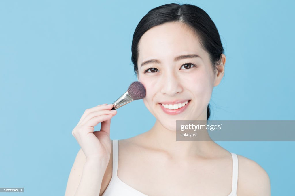 portrait of young asian woman beauty image on blue background : Stock Photo