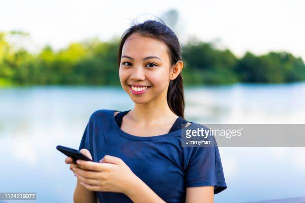 portrait of young asian woman by a lake - filipino ethnicity and female not male stock pictures, royalty-free photos & images